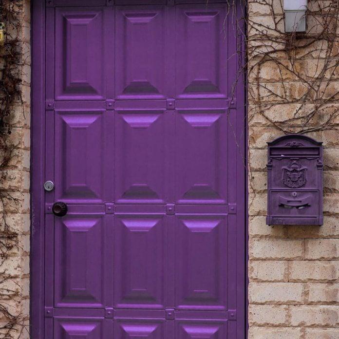 shutterstock_602113925 purple front door brick house