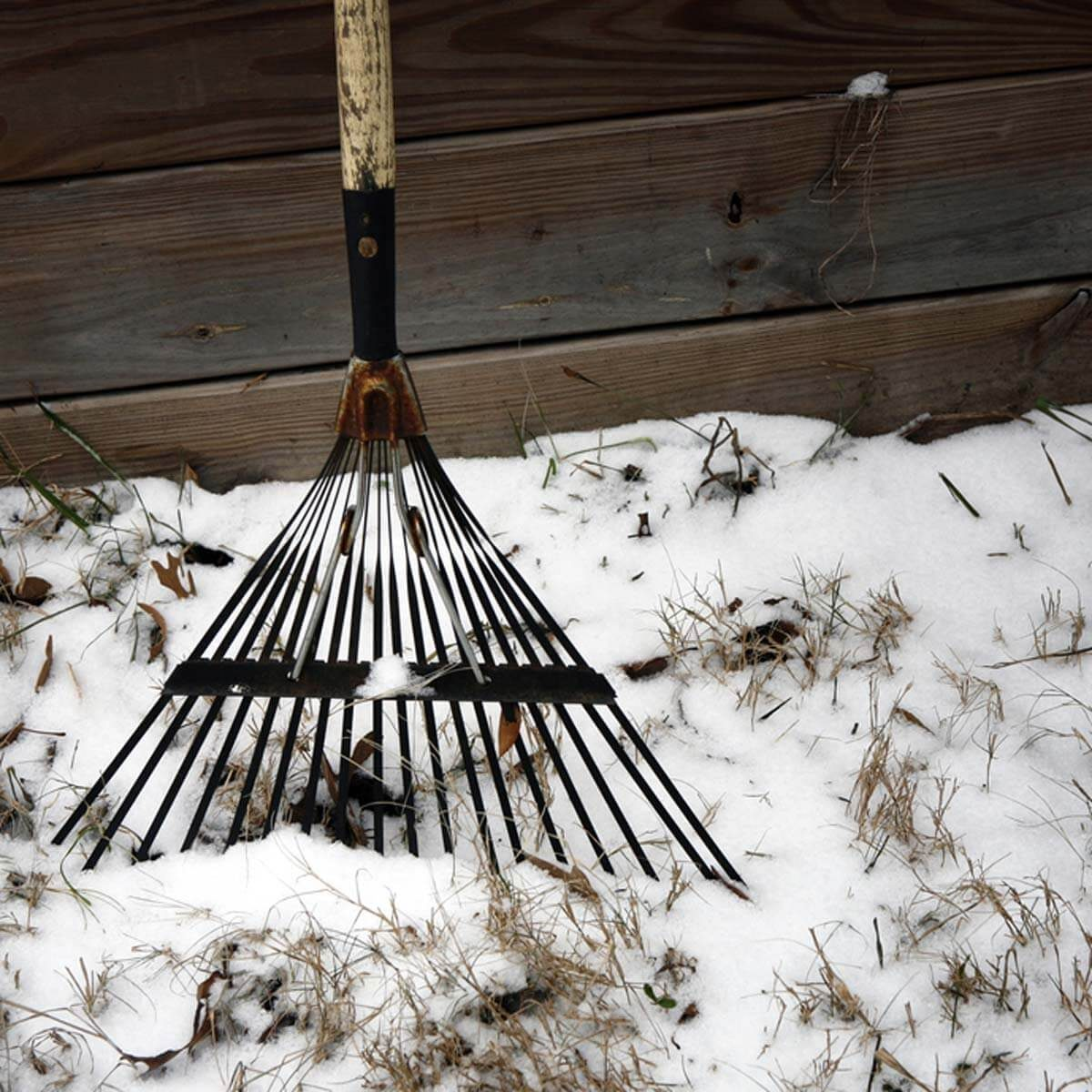 shutterstock_70463974 rake in winter snow
