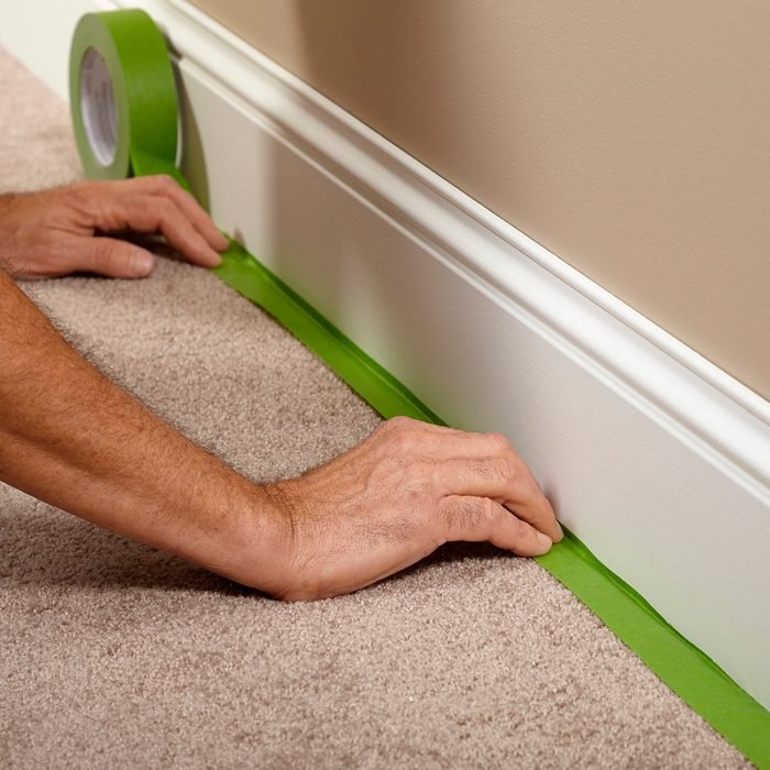 Taping off the carpet before painting   Construction Pro Tips