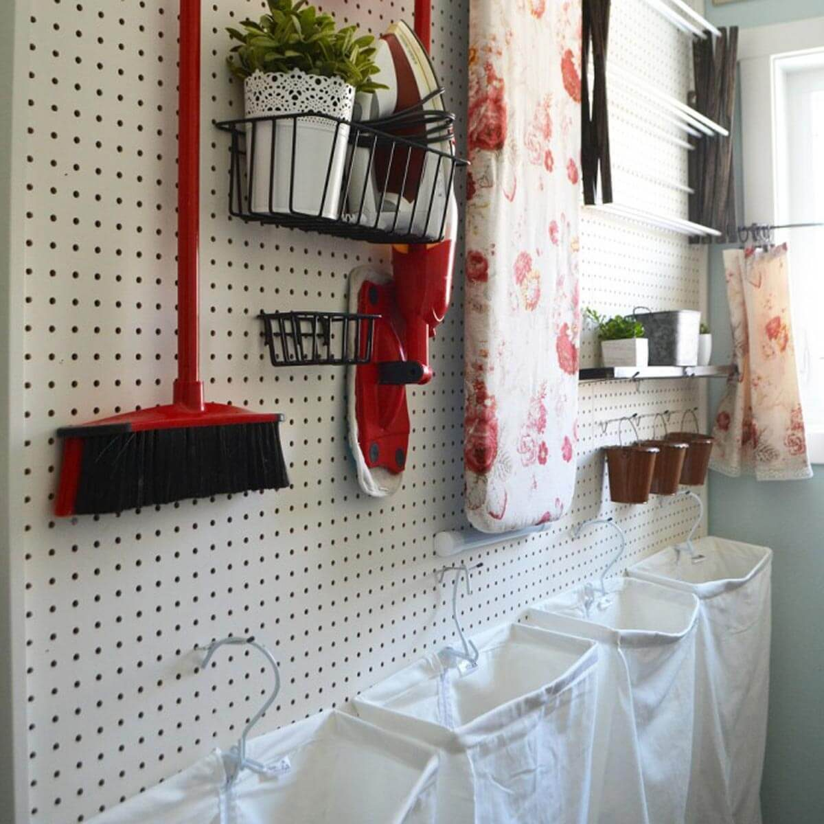 Vintage-Red-Aqua-Pegboard-Laundry-Room-Design-Ideas-7-714x1000 hanging hampers