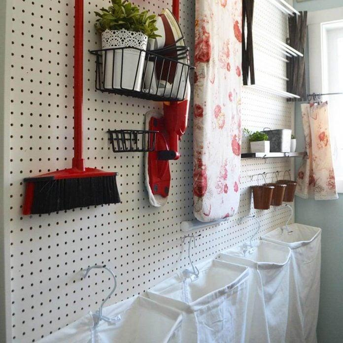 Vintage-Red-Aqua-Pegboard-Laundry-Room-Design-Ideas-7-714x1000 hanging hampers