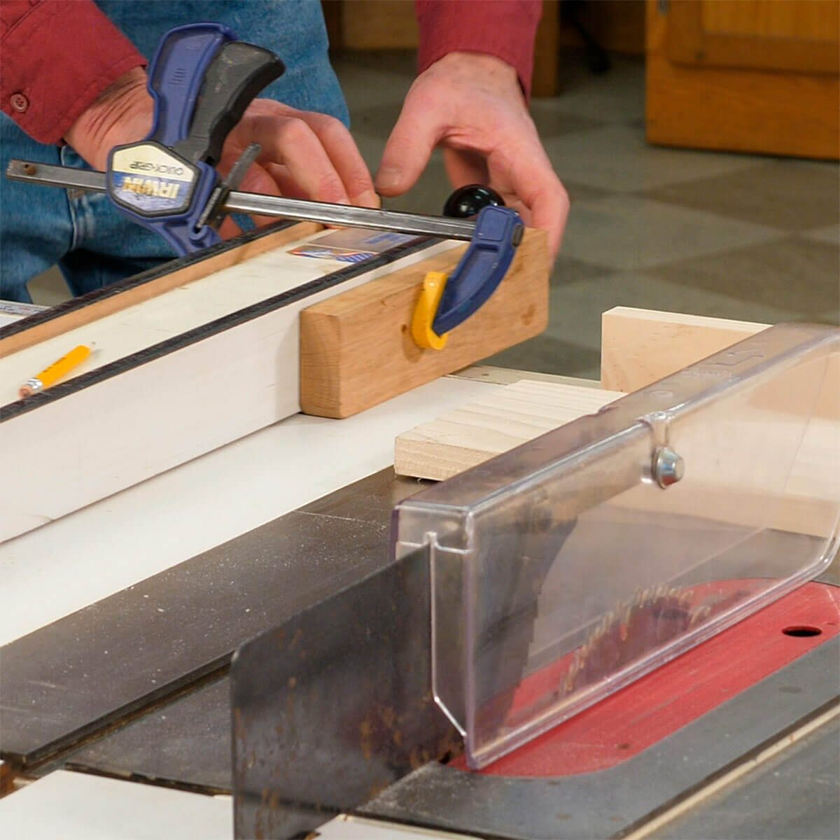 clamp a board to table saw fence