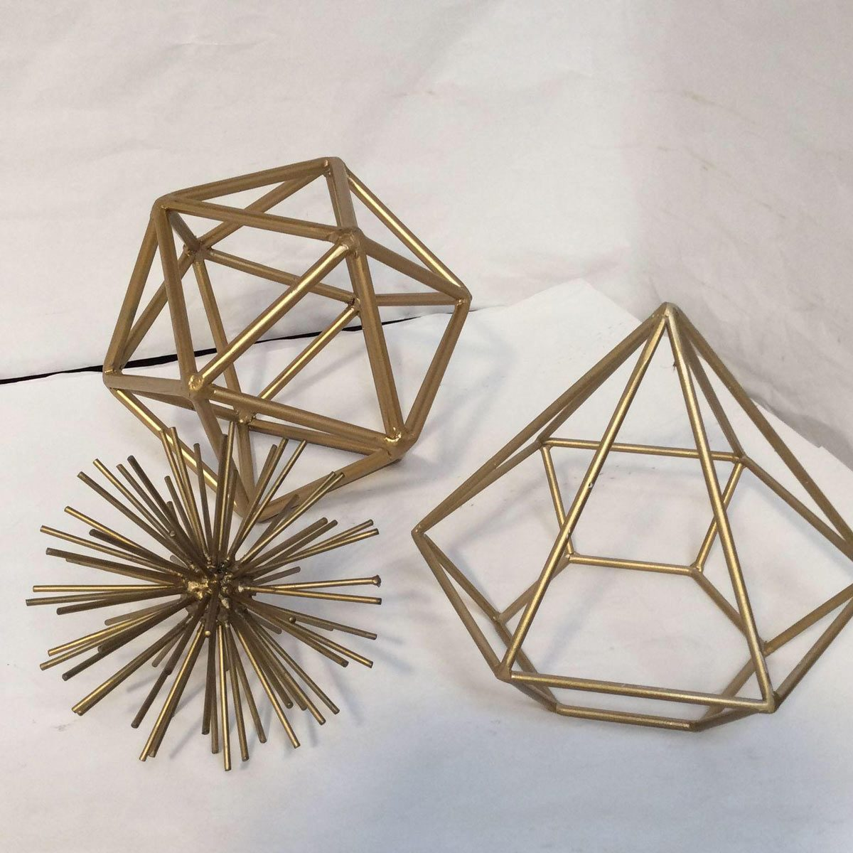 gold metal geometric shapes