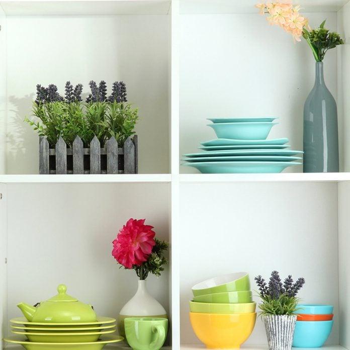 shutterstock_126715268 open shelving kitchen bowls organization
