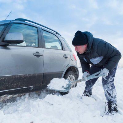 shovel-snow-stuck-car-winter-storm