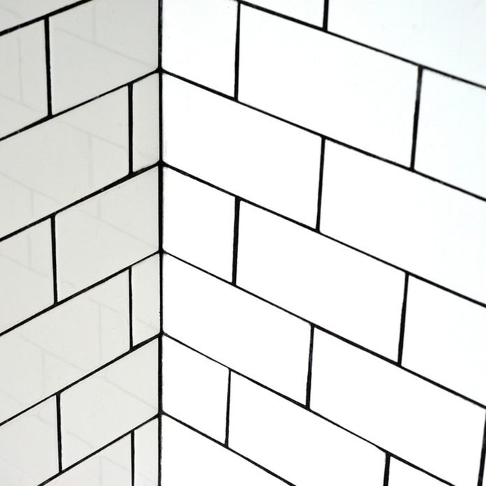 shutterstock_416547448 white subway tile and black grout
