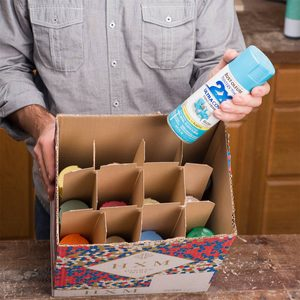 storing spray paint in a wine box
