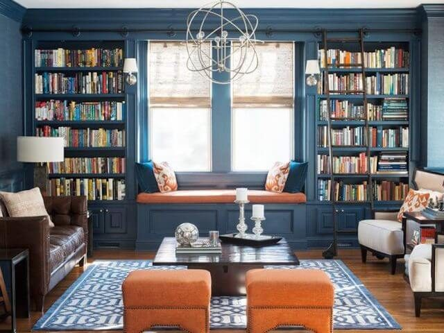 large blue bookcase with window seat