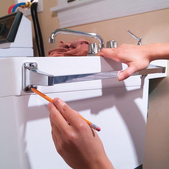 attach towel bar laundry sink