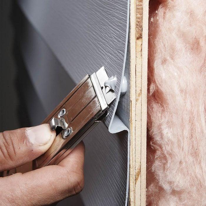 Fix Holes in Siding
