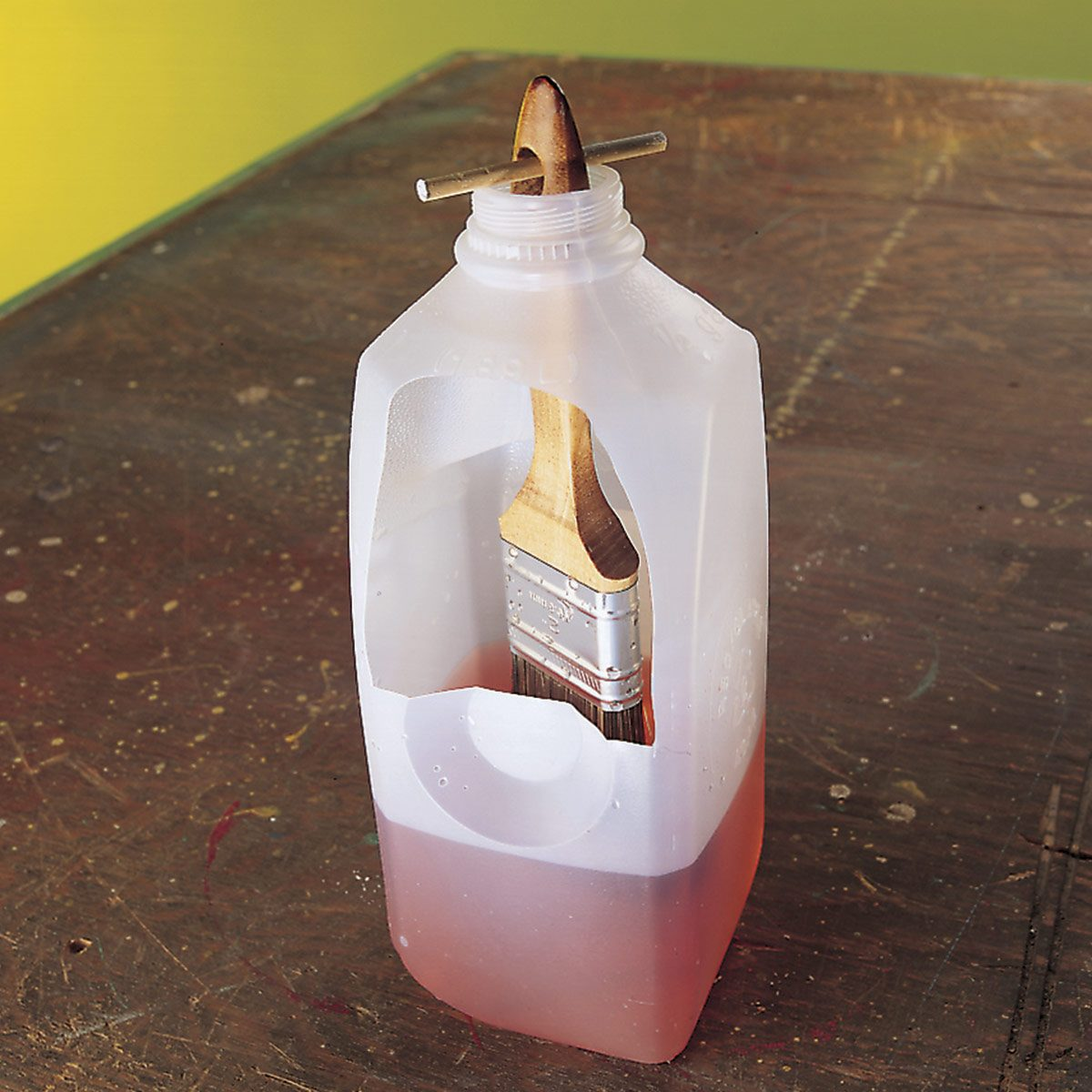 brush cleaning in milk jug