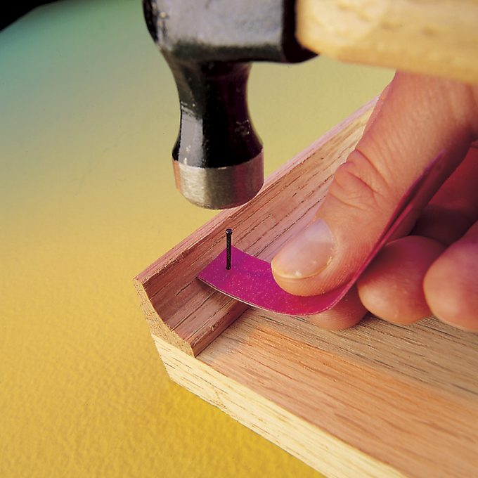 nail holder with hammer