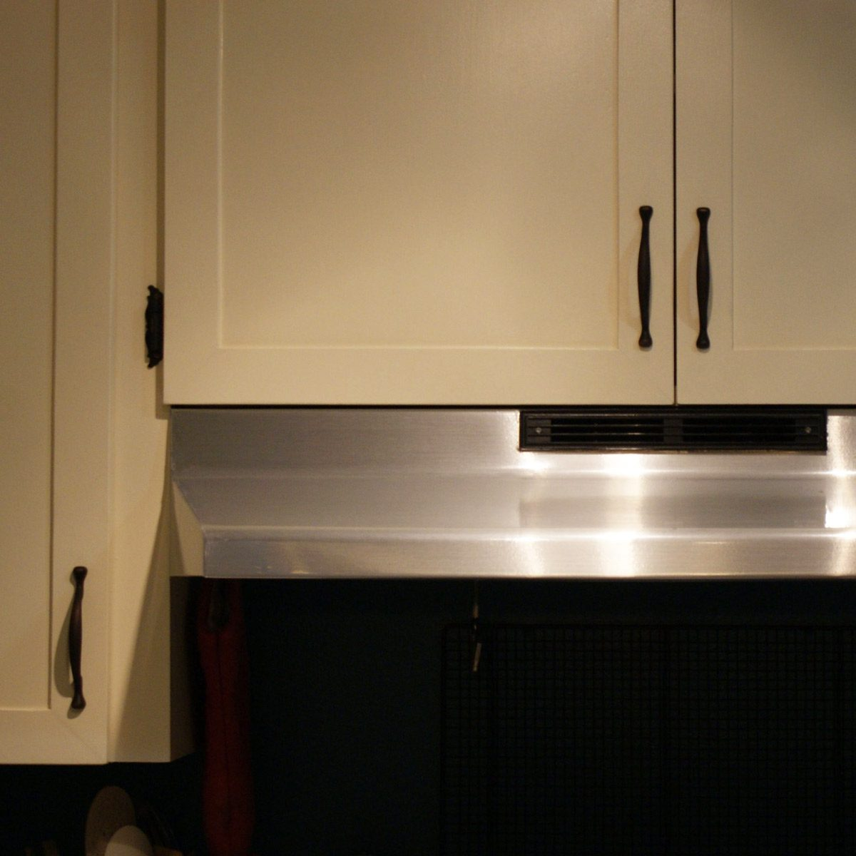 Creative ways to disguise a range hood vent the family handyman stainless steel faux range hood solutioingenieria Images