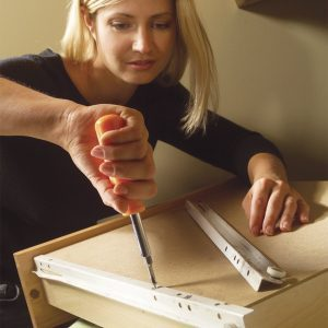 Person Replacing Drawer Slides