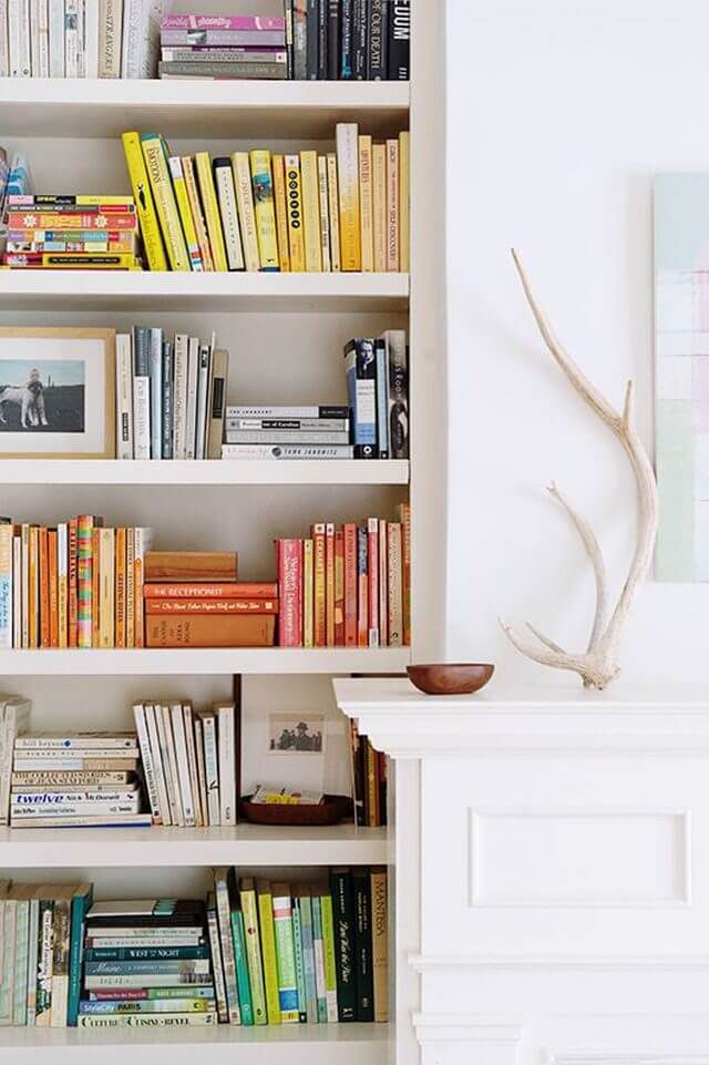 color-coordinating decorating on bookcase
