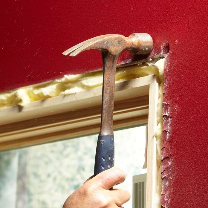 Knocking back projecting drywall with a hammer | Construction Pro Tips