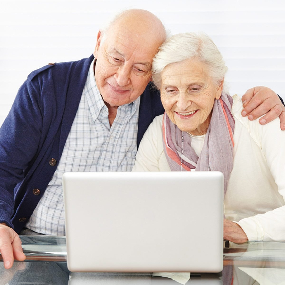 retired couple at a computer