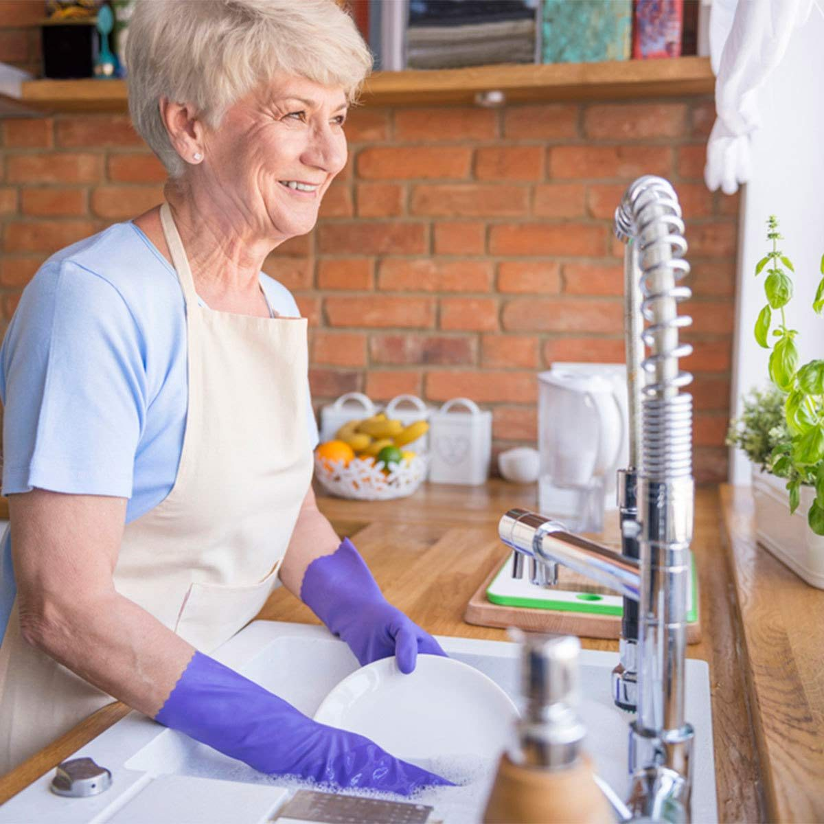 woman washing dishes in sink