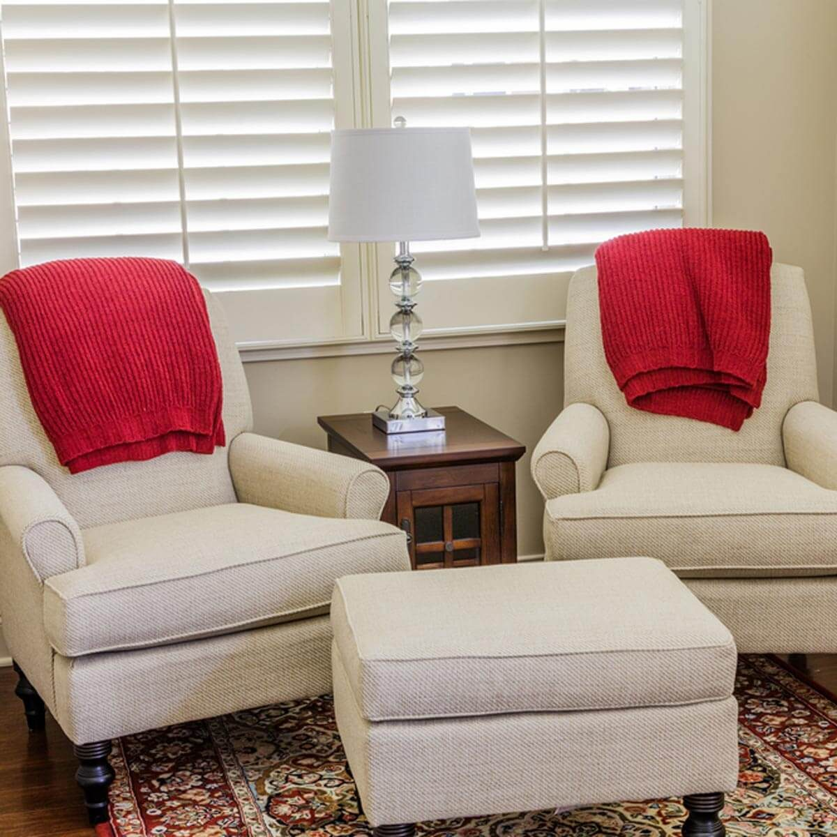 cream arm chairs traditional rug