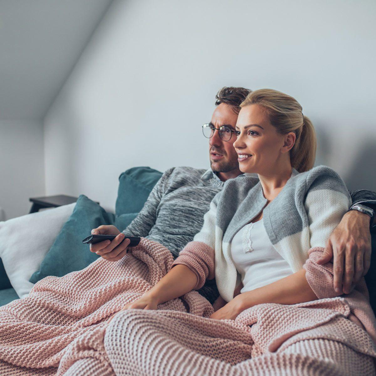 couple watching movie cuddling