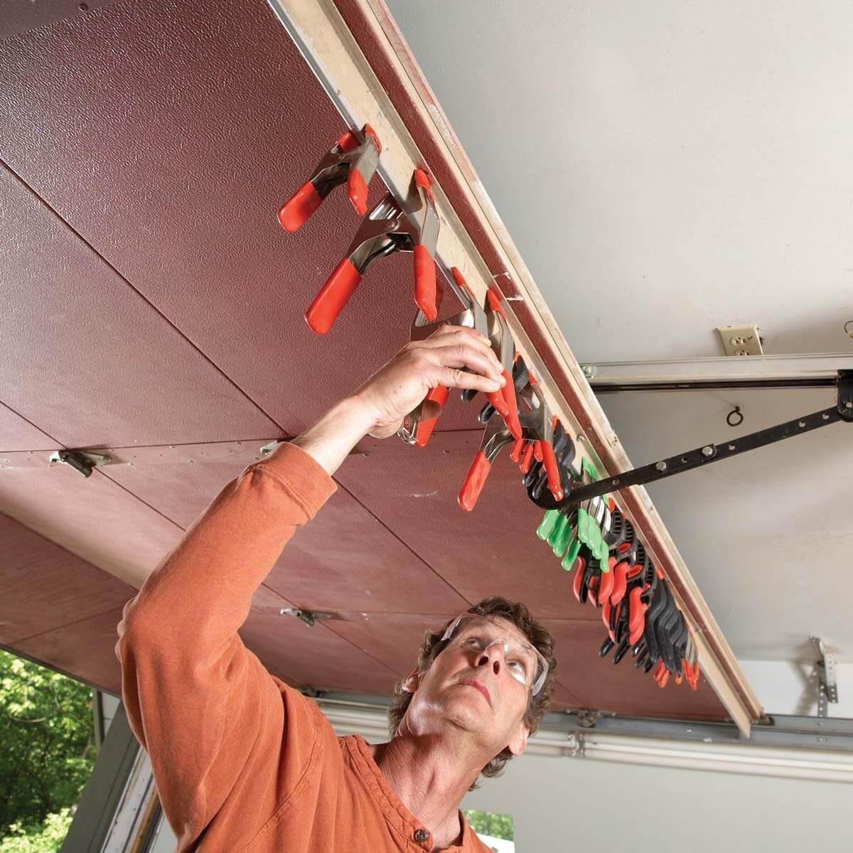overhead spring clamps — shop tip from the family handyman