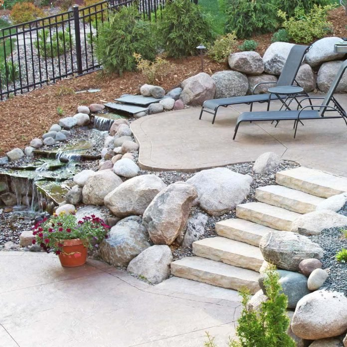 Multi-level patio designs with water feature
