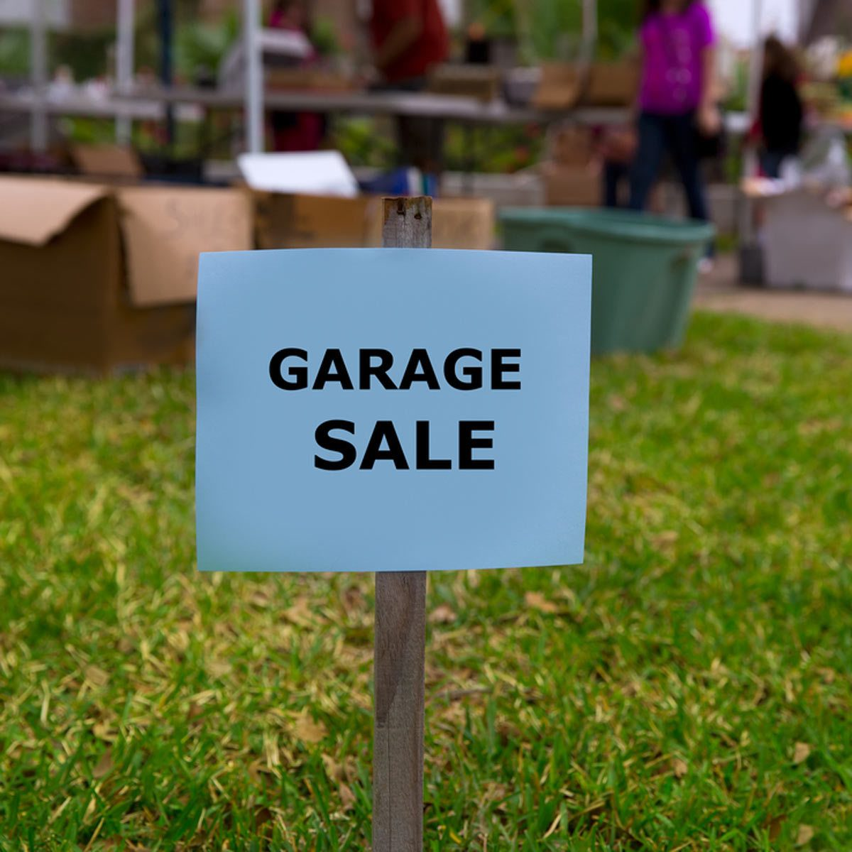 garage sale sign in yard