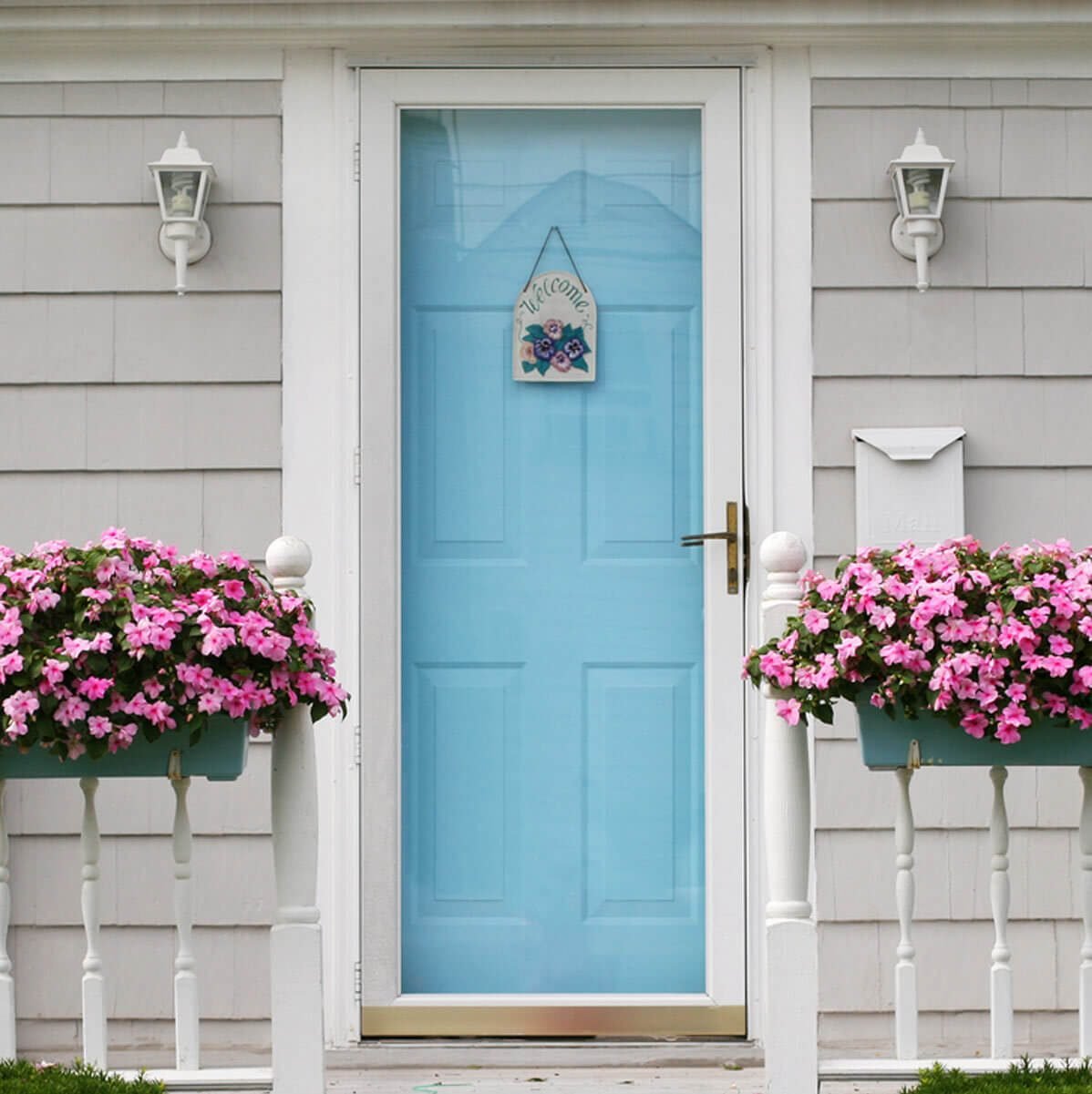 Light Blue Front Door with Planter Boxes