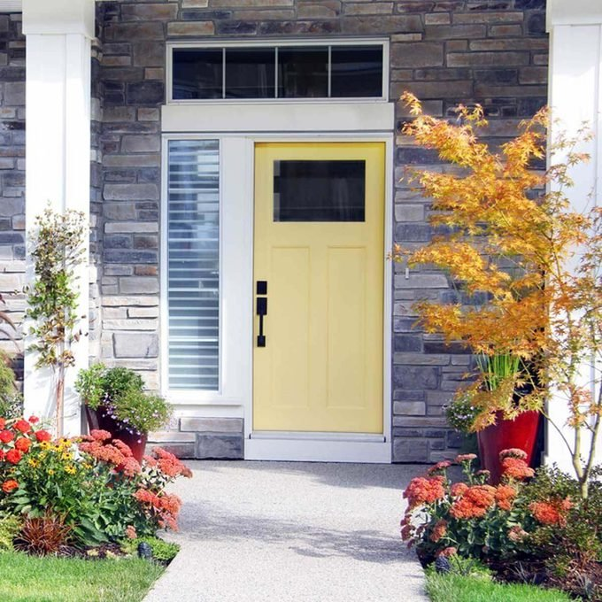 Yellow Front Door with Landscaping