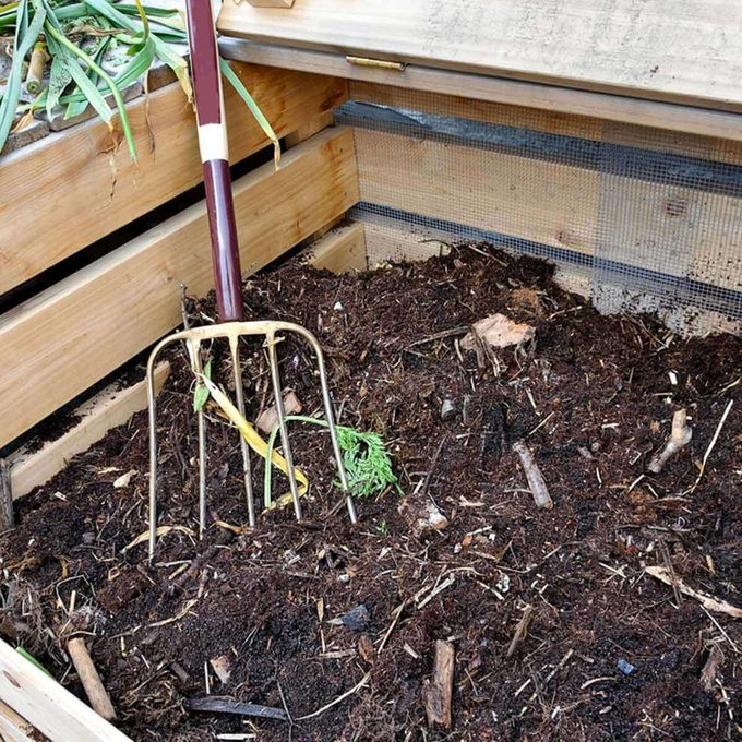 pitch fork in compost pile