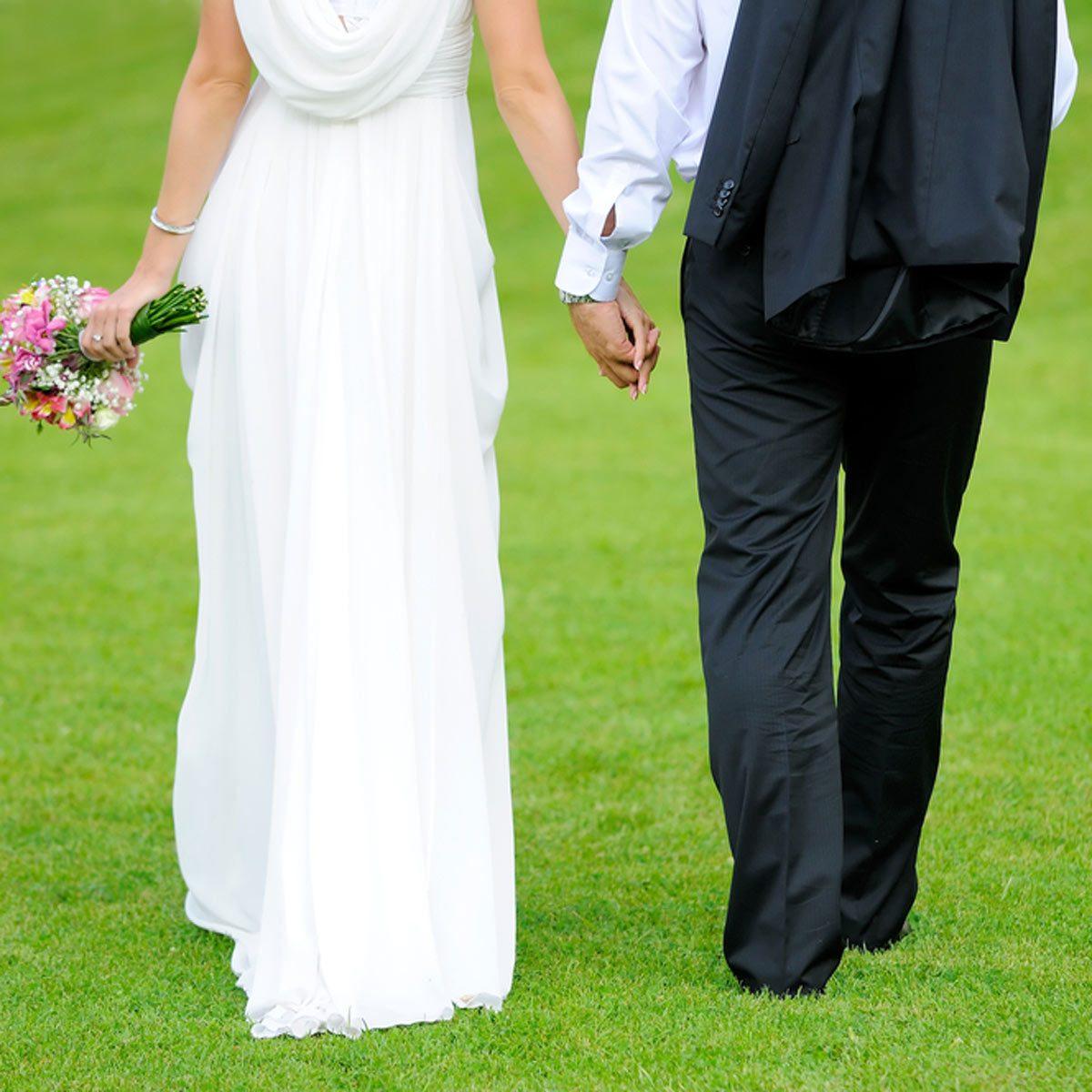 backyard wedding green grass bride and groom