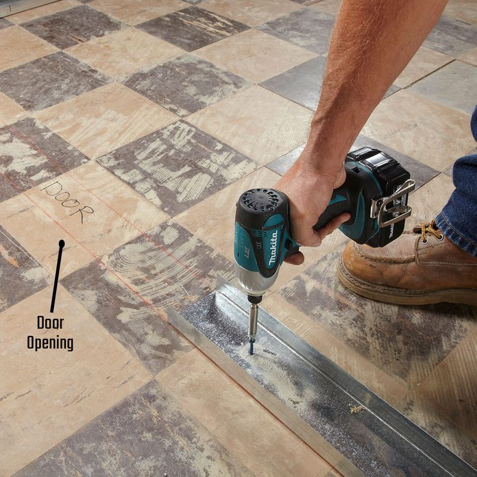 Laying track up to the door opening | Construction Pro Tips