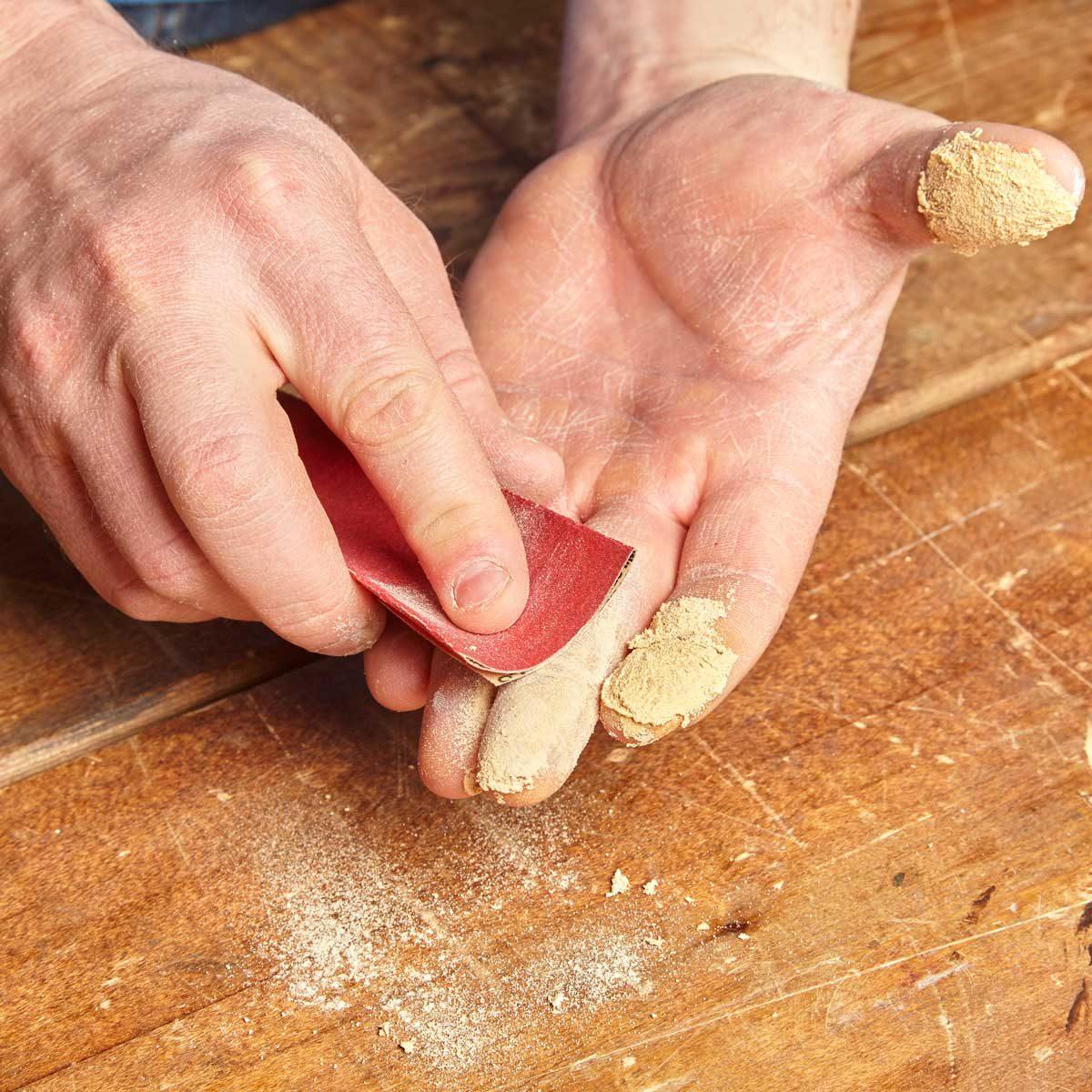remove super glue with sandpaper