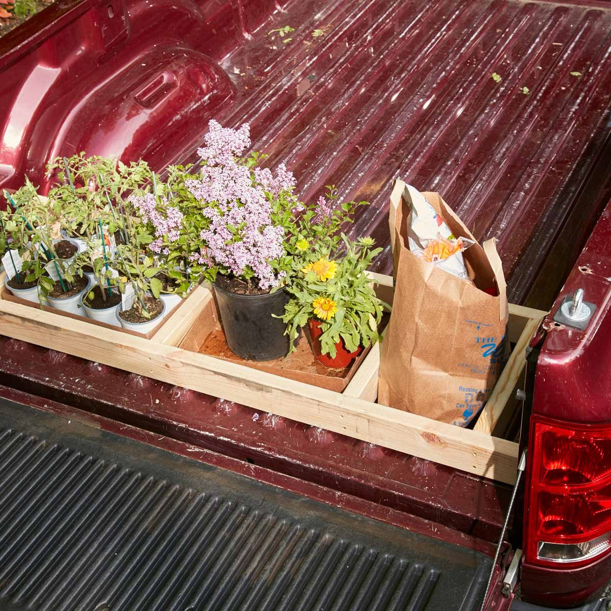 A Wood Pickup Truck Bed Divider To Keep Your Stuff From