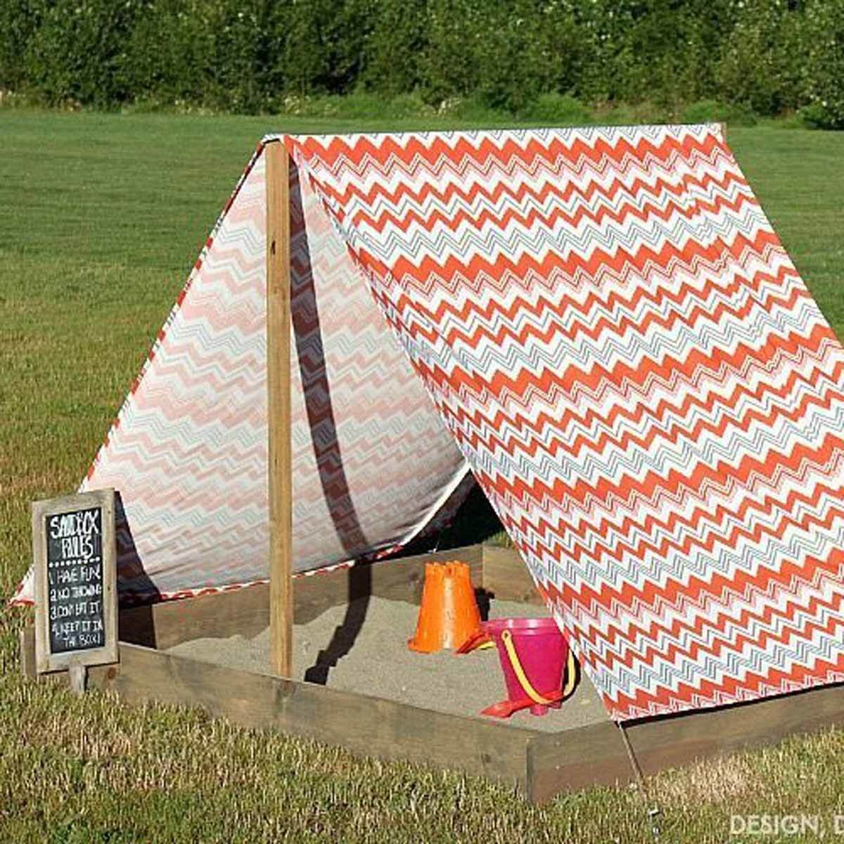 sandbox with tent