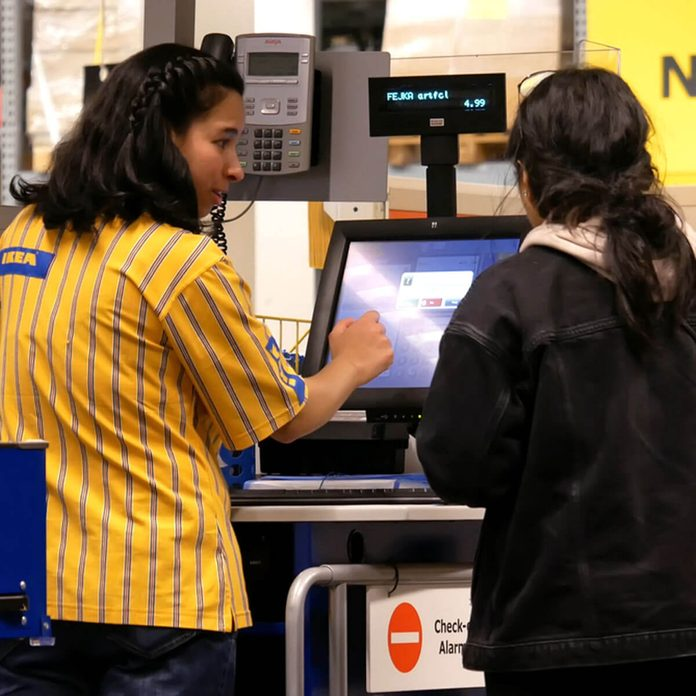 Ikea employees cashier check out