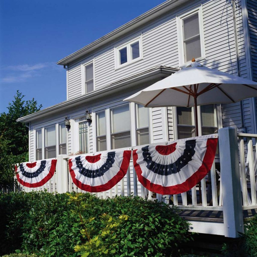patriotic bunting hanging from a deck railing