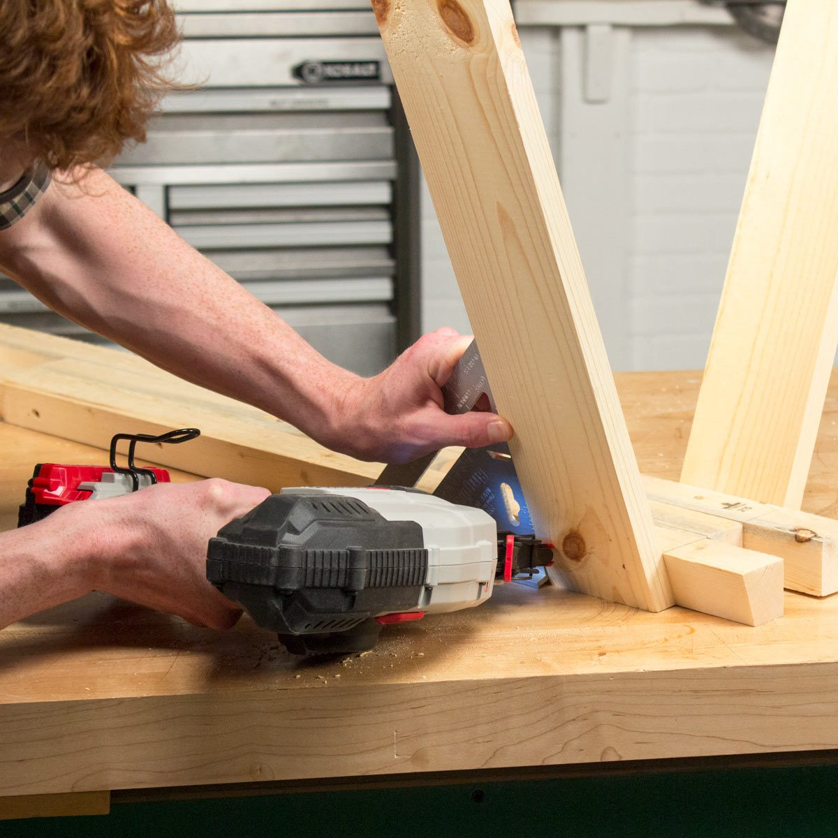 Adjustable Sawhorse Create and attach legs to the top assembly