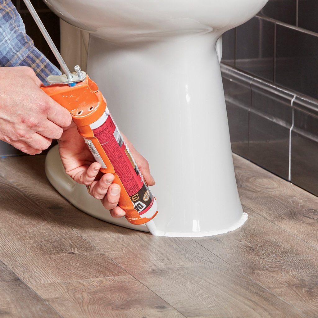 Caulking around the base of a toilet | Construction Pro Tips