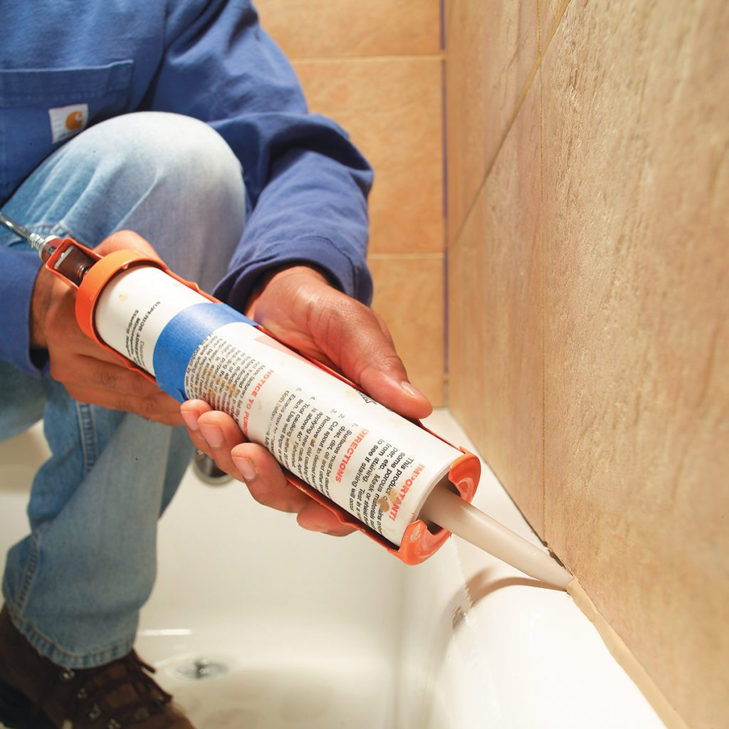 Caulking the tile seam in a bathtub | Construction Pro Tips