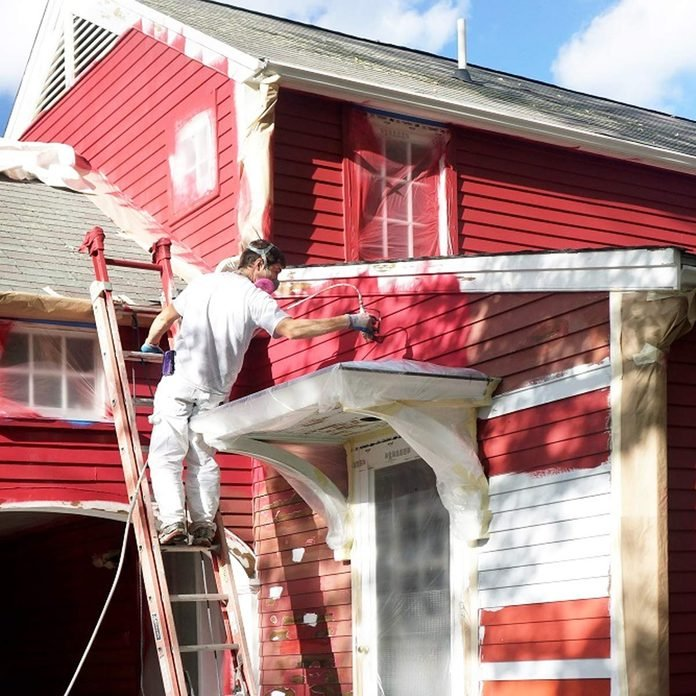 painting exterior of home red white window trim