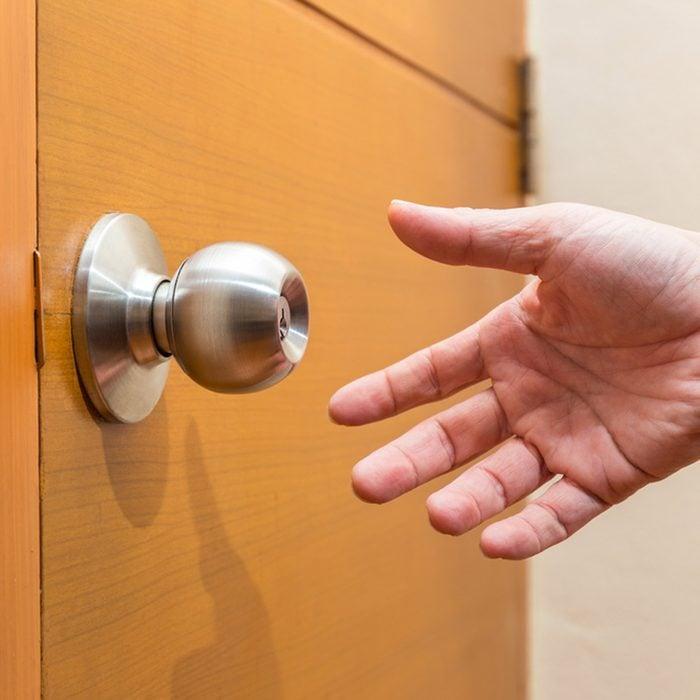 reaching for door handle to open door