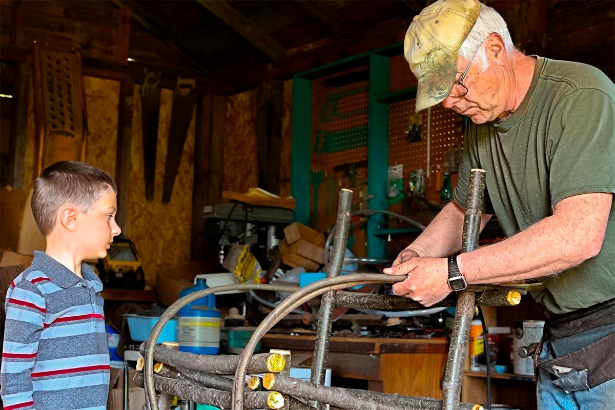 Grandpa building willow chair