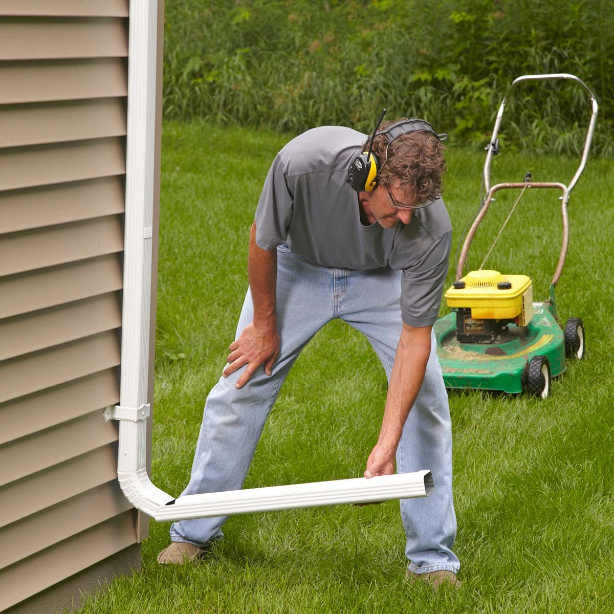how to make stay-put downspout extensions   the family handyman