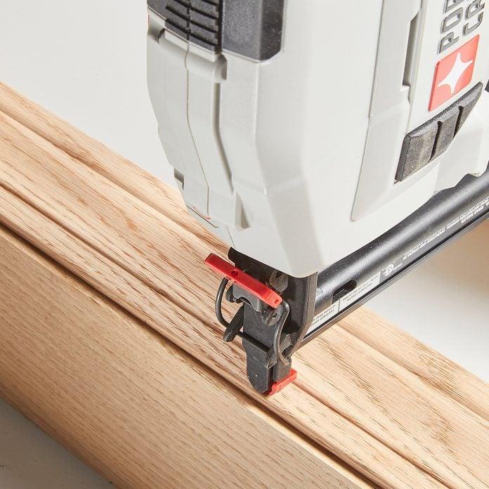 The tip of a brad nailer | Construction Pro Tips