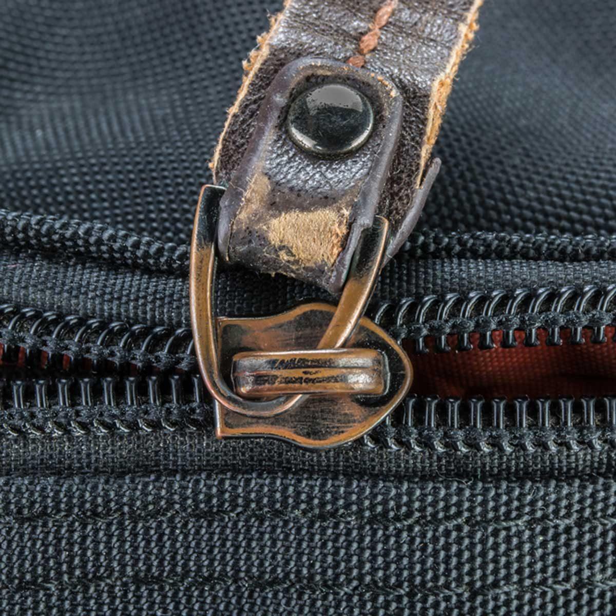 putting zipper slider back on