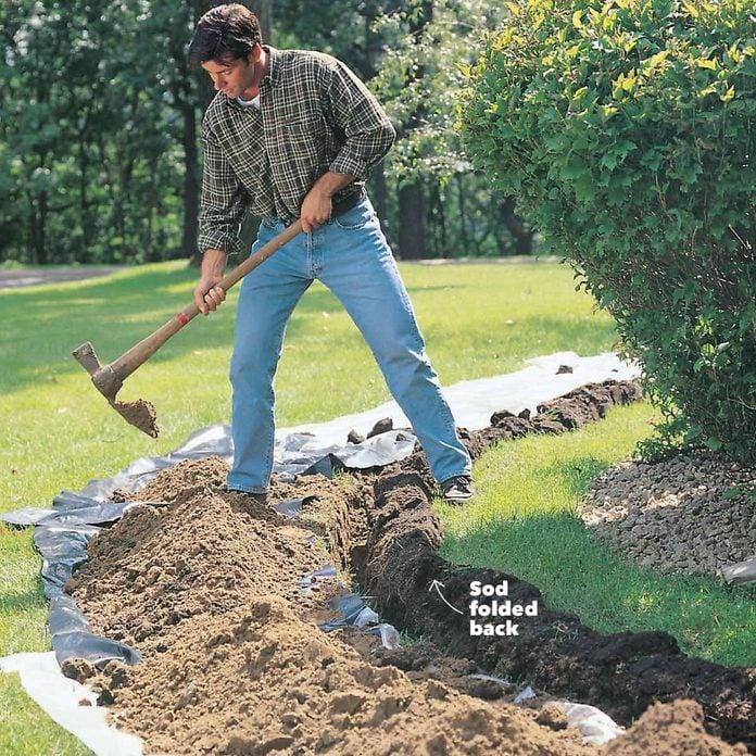 fold back the sod digging holes