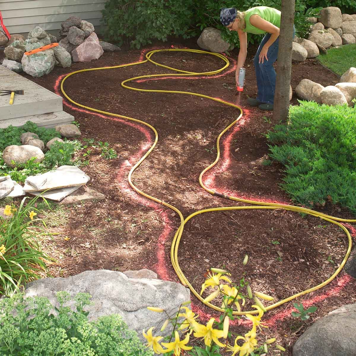 mark hole with hose and paint digging pond