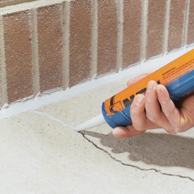caulk a crack in concrete