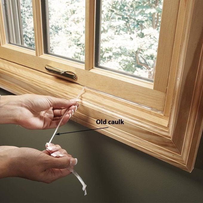 removing caulk from window